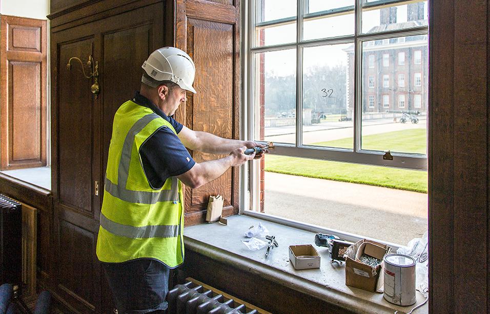 Royal Hospital, Chelsea, London: a worker refurbishing the sash windows