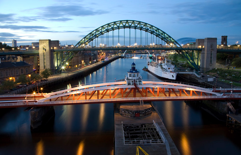 The Swing Bridge and the Tyne Bridge over the River Tyne between Newcastle-upon-Tyne (left) and Gateshead (right) at dusk