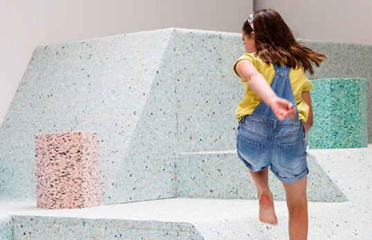 Girl plays in The Brutalist Playground by Assemble and Simon Terrill