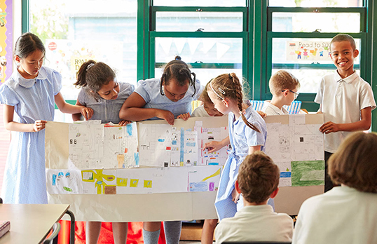 Children with a large planning document
