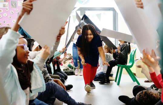 Girl walks under boards on Architecture Ambassadors programme