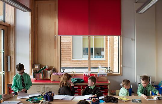 Children in a classroom at Ysgol Trimsaran