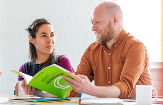 Two people reviewing a RIBA contract