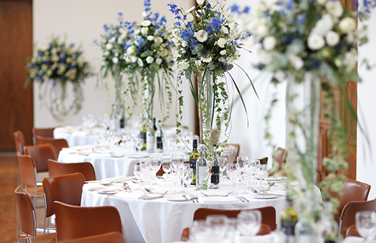 Tables with flowers in vases
