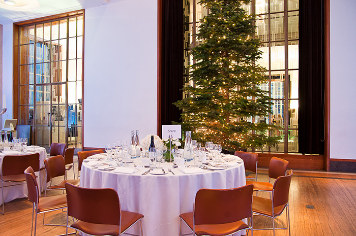 Christmas tree stands with tables set for dinner